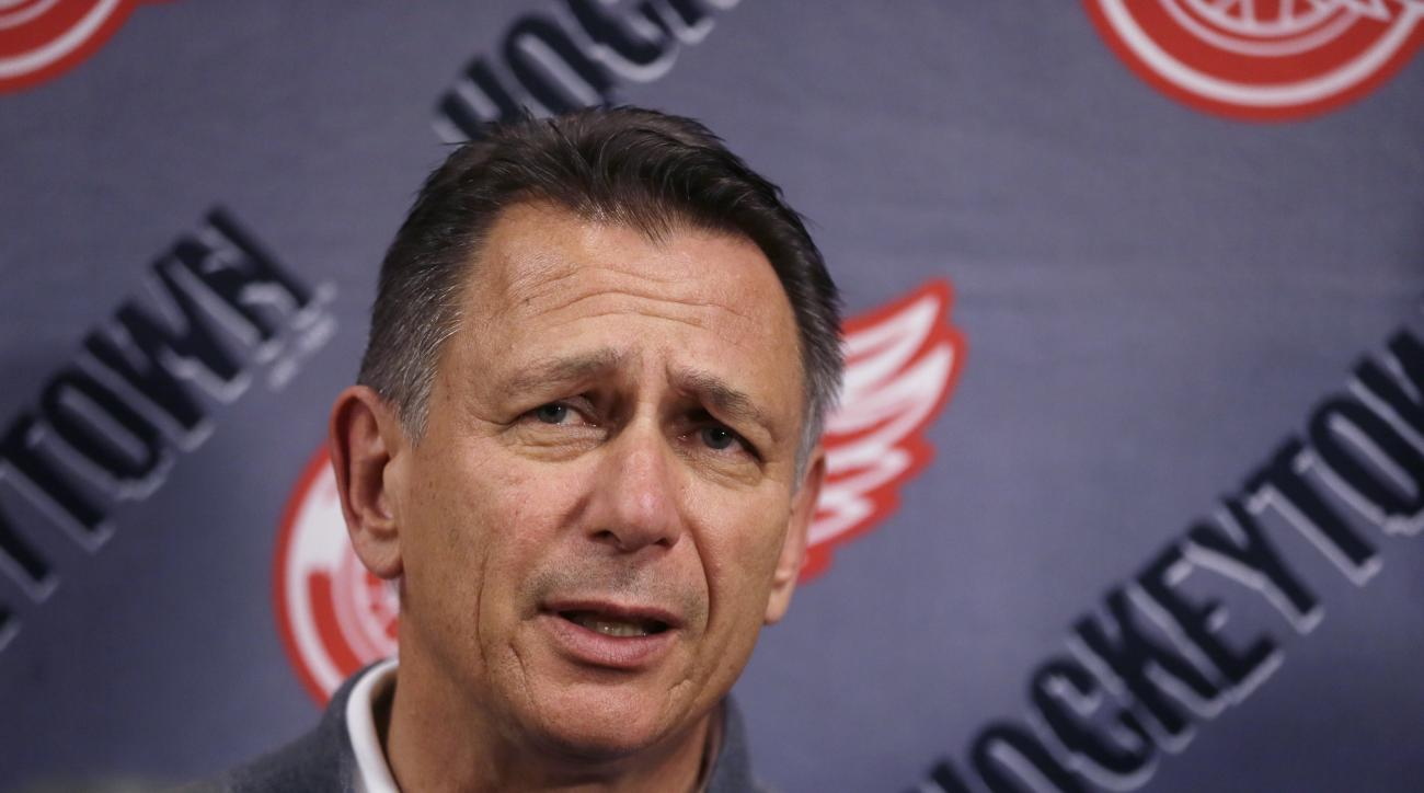 Detroit Red Wings General Manager Ken Holland addresses the media, Wednesday, May 20, 2015, in Detroit to discuss the head coaching vacancy as coach Mike Babcock will now be the new head hockey coach with the Toronto Maple Leafs. (AP Photo/Carlos Osorio)