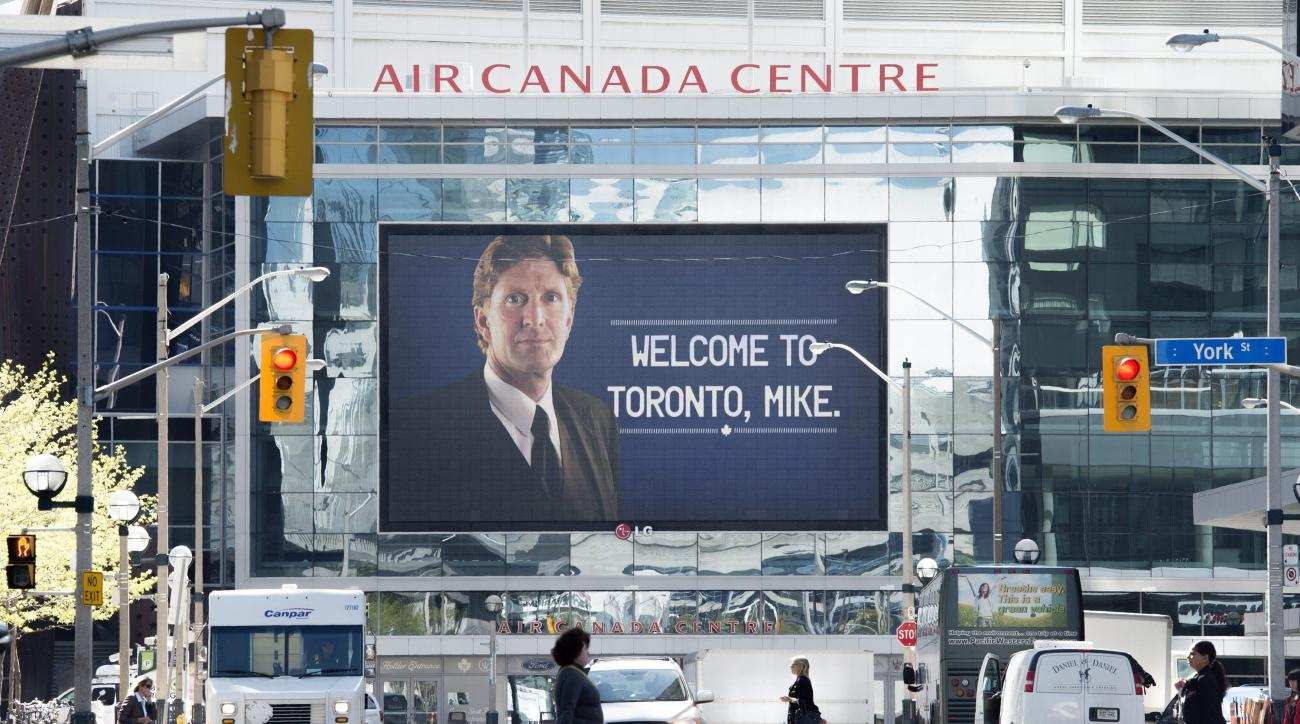 A sign welcoming Mike Babcock as the new head coach of the Toronto Maple Leafs NHL hockey club is displayed outside of the Air Canada Centre in Toronto, Thursday, May 21, 2015. Babcock spent the last 10 seasons with the Detroit Red Wings, where he won the