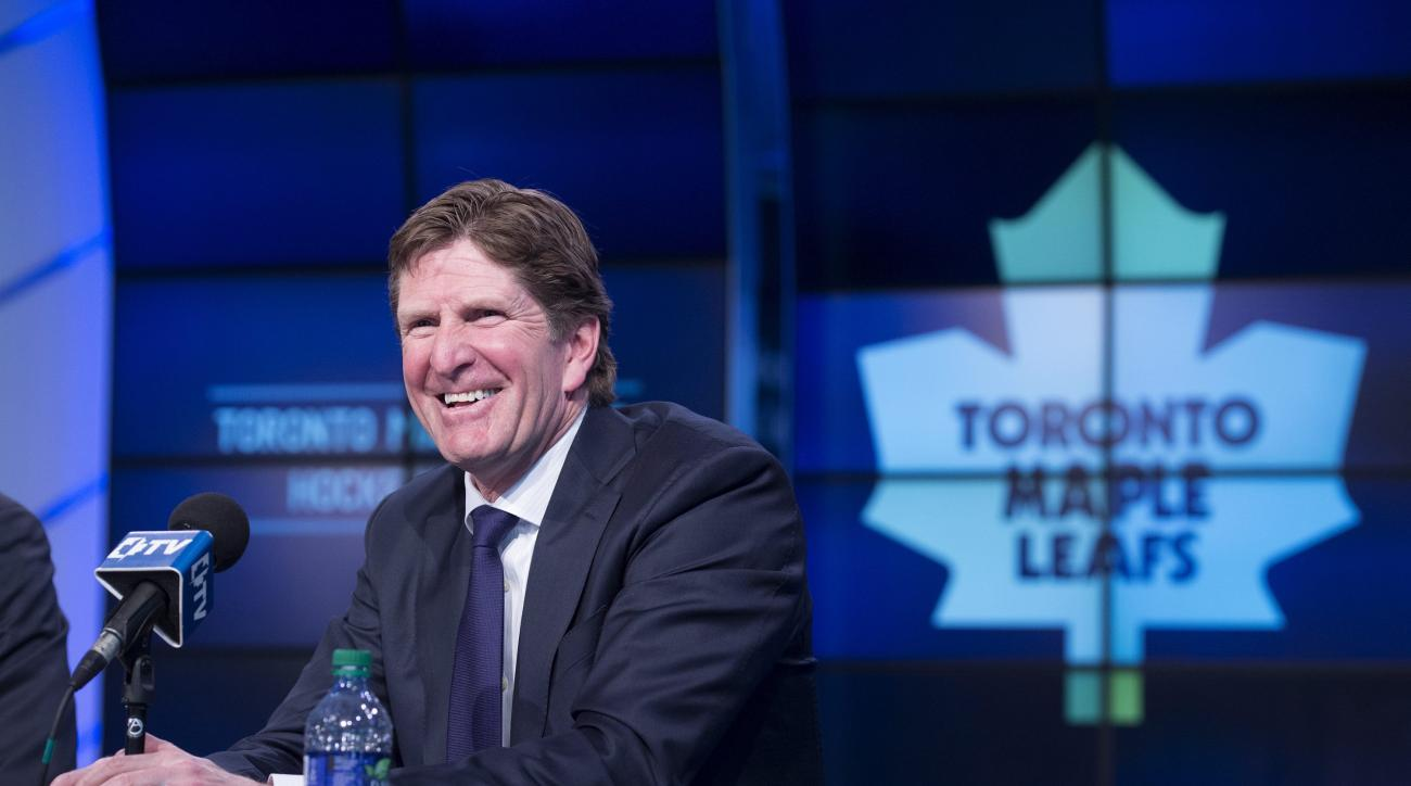 Toronto Maple Leafs' new head coach Mike Babcock laughs during an NHL hockey press conference in Toronto, Thursday, May 21, 2015.  Babcock spent the last 10 seasons with the Detroit Red Wings, where he won the Stanley Cup in 2008. (Darren Calabrese/The Ca