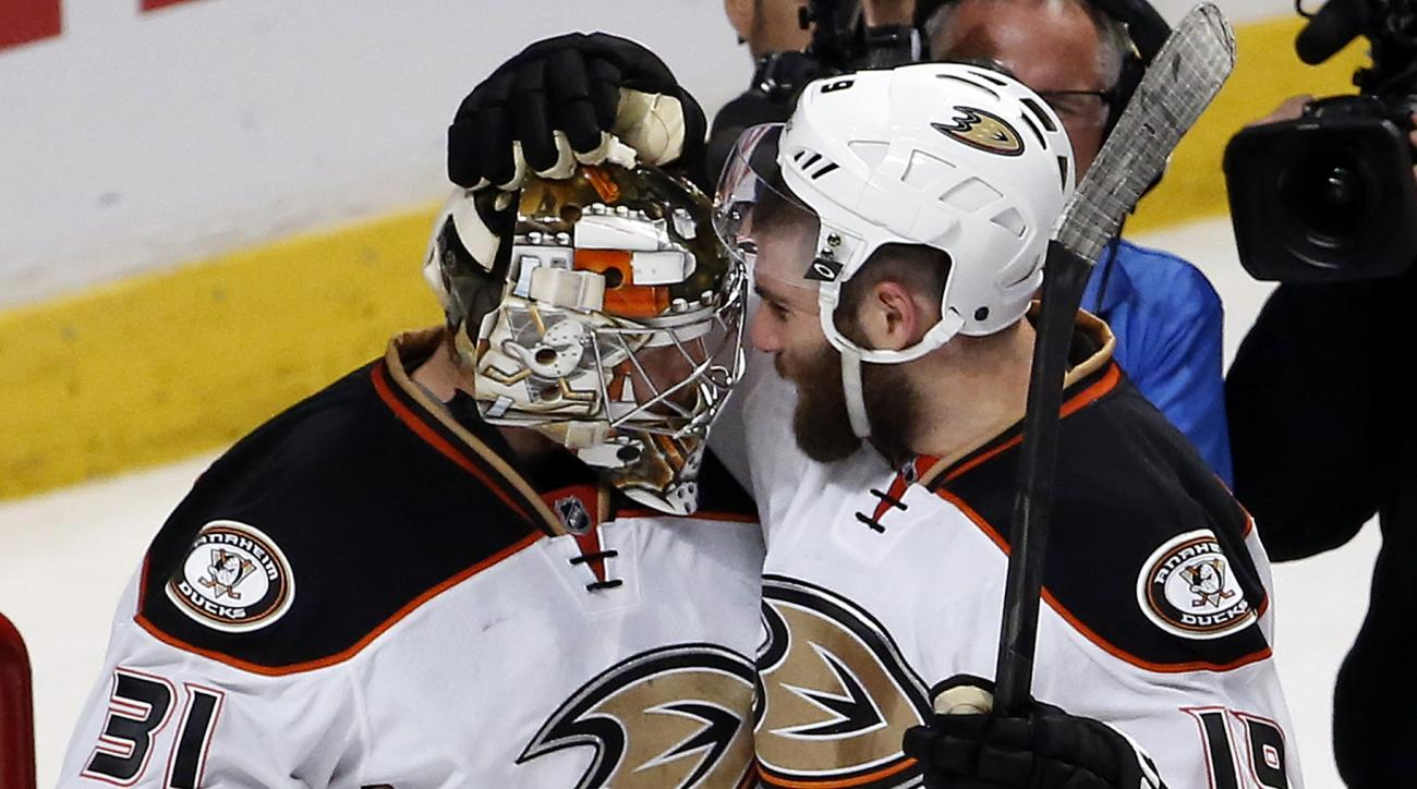 Anaheim Ducks goalie Frederik Andersen, left, and left wing Patrick Maroon celebrate after Game 3 of the Western Conference finals against the Chicago Blackhawks in the NHL hockey Stanley Cup playoffs, Thursday, May 21, 2015, in Chicago. The Ducks won 2-1