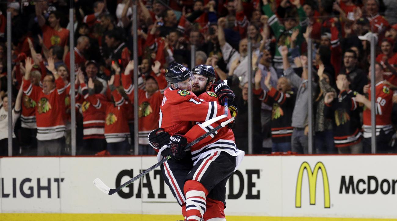 Chicago Blackhawks defenseman Brent Seabrook, right, celebrates his goal against the Anaheim Ducks with Jonathan Toews during the third period in Game 4 of the Western Conference finals of the NHL hockey Stanley Cup playoffs, Saturday, May 23, 2015, in Ch