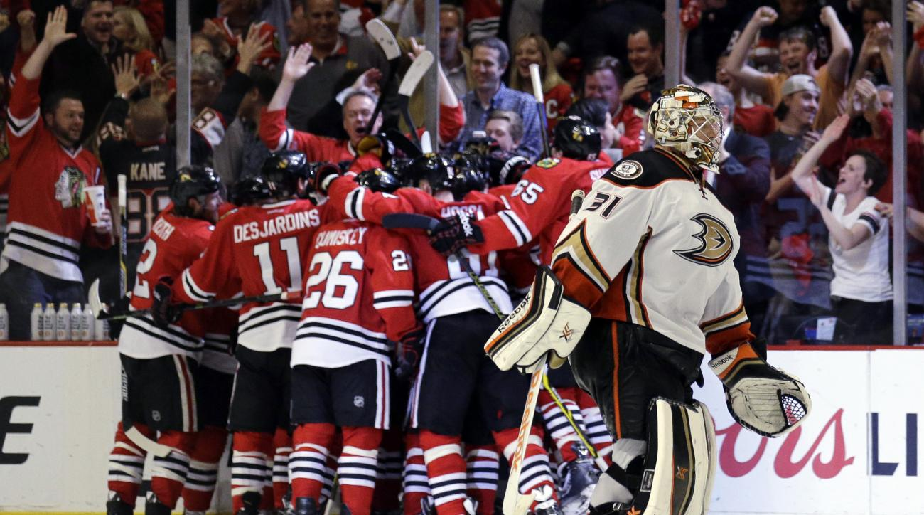 Anaheim Ducks goalie Frederik Andersen skates off the ice as Chicago Blackhawks celebrate an Antoine Vermette goal during the second overtime in Game 4 of the Western Conference finals of the NHL hockey Stanley Cup Playoffs, Saturday, May 23, 2015, in Chi