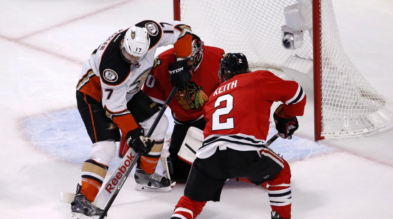 Anaheim Ducks center Ryan Kesler (17) tries to shoot on Chicago Blackhawks goalie Corey Crawford  as defenseman Duncan Keith (2) defends during the first period in Game 6 of the Western Conference finals of the NHL hockey Stanley Cup playoffs, Wednesday,