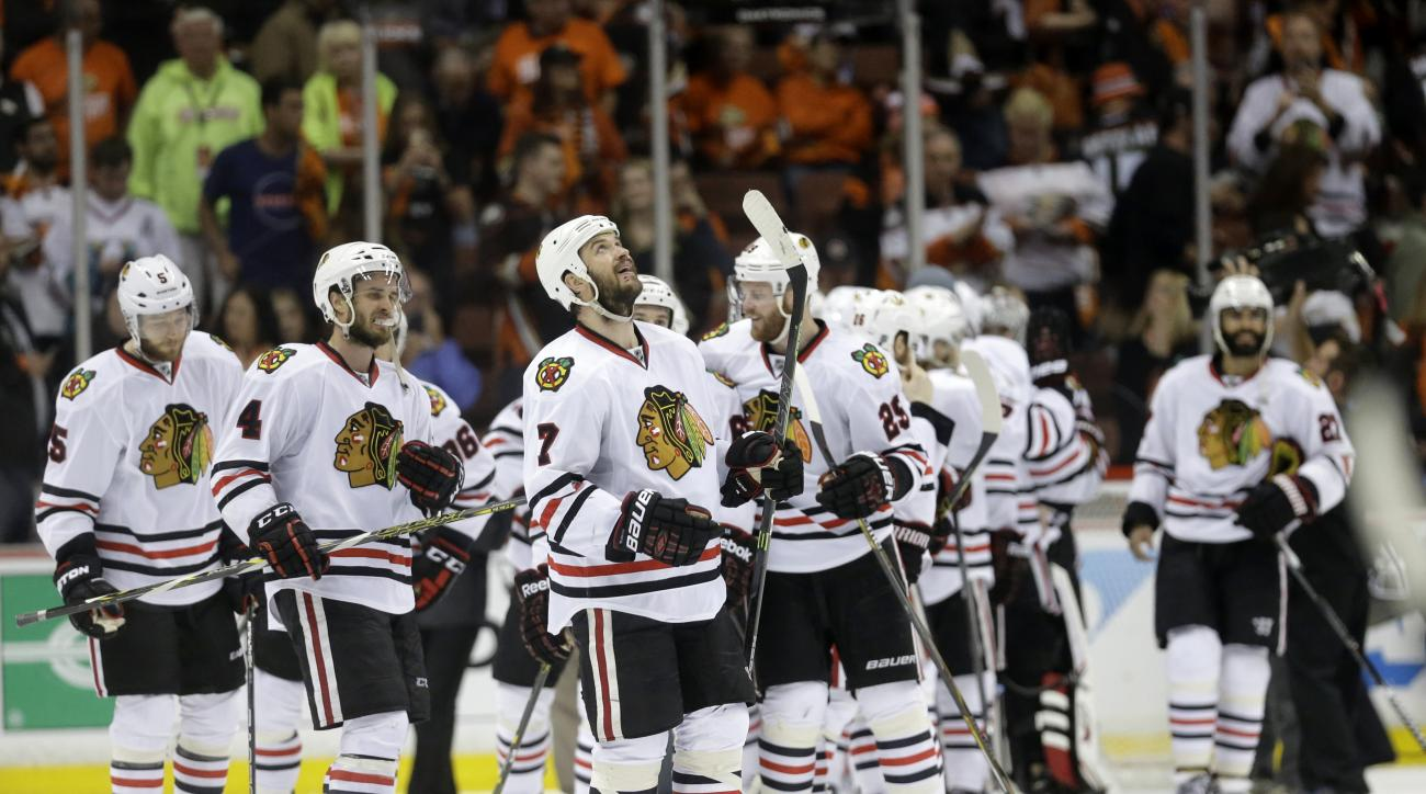 Members of the Chicago Blackhawks celebrate their win against the Anaheim Ducks in Game 7 of the Western Conference final of the NHL hockey Stanley Cup playoffs in Anaheim, Calif., Saturday, May 30, 2015. The Blackhawks won 5-3 to advance to Stanley Cup F