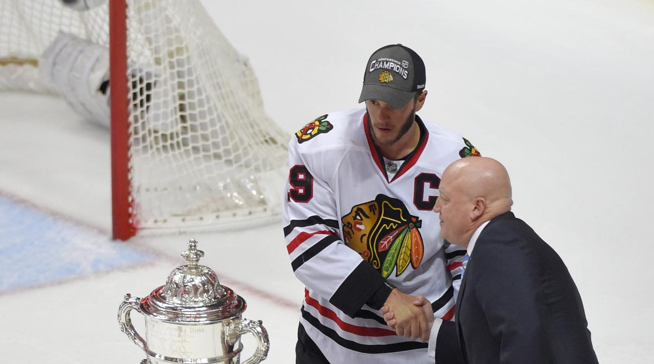 Bill L. Daly, right, National Hockey League's Deputy Commissioner, greets Chicago Blackhawks center Jonathan Toews after their win against the Anaheim Ducks in Game 7 of the Western Conference final of the NHL hockey Stanley Cup playoffs in Anaheim, Calif