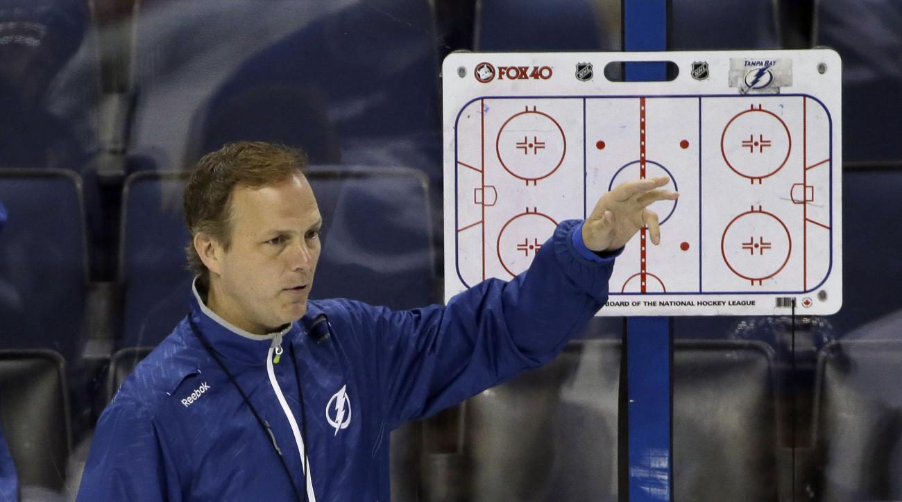 Tampa Bay Lightning head coach Jon Cooper goes over plays during NHL hockey practice at Amalie Arena for the Stanley Cup Finals, Tuesday, June 2, 2015, in Tampa, Fla. The Lightning will take on the Chicago Blackhawks in Game 1 on Wednesday.  (AP Photo/Chr