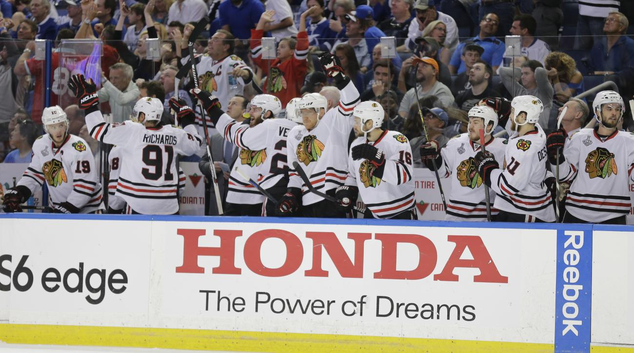 The Chicago Blackhawks bench reacts after Antoine Vermette's game winning goal during the third period in Game 1 of the NHL hockey Stanley Cup Final against the Tampa Bay Lightning in Tampa, Fla., Wednesday, June 3, 2015.  The Blackhawks defeated the Ligh