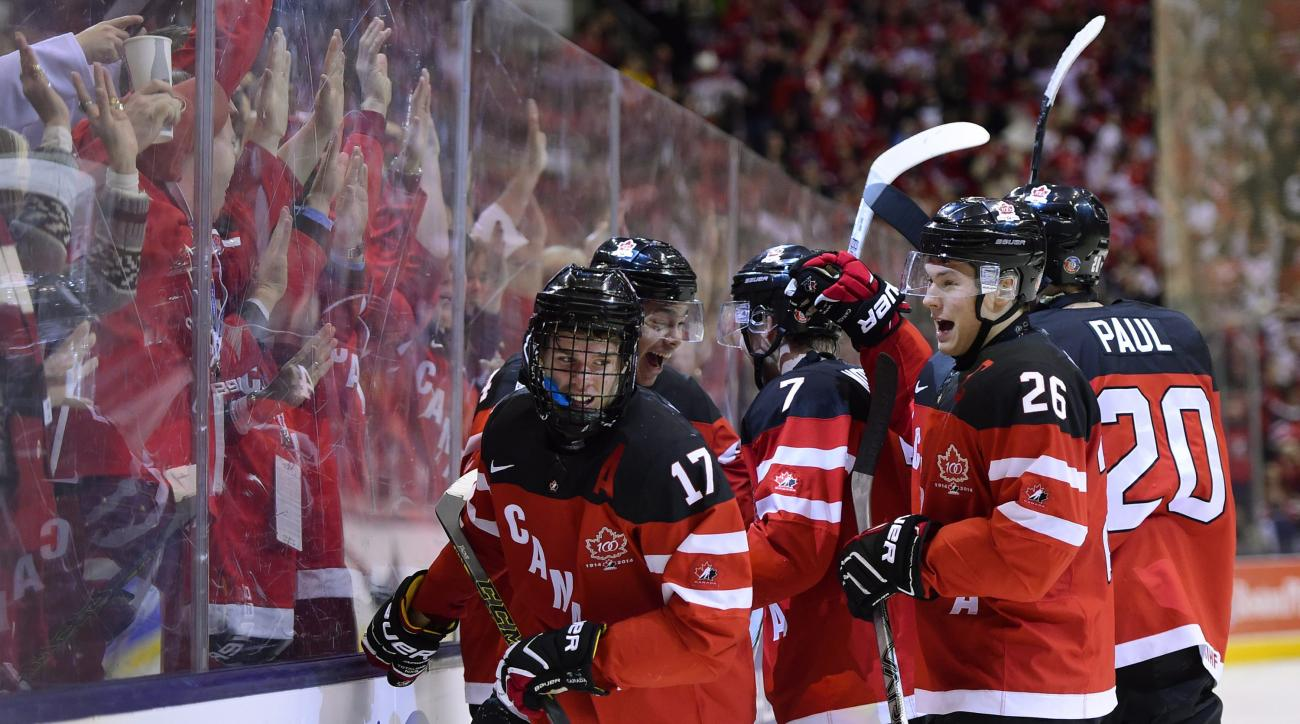 FILE - In this January, 2015 file photo, Canada's Connor McDavid (17) celebrates his second-period goal against Russia during the title game at the hockey World Junior Championship in Toronto. Though he's yet to be drafted, McDavid has landed his first ma