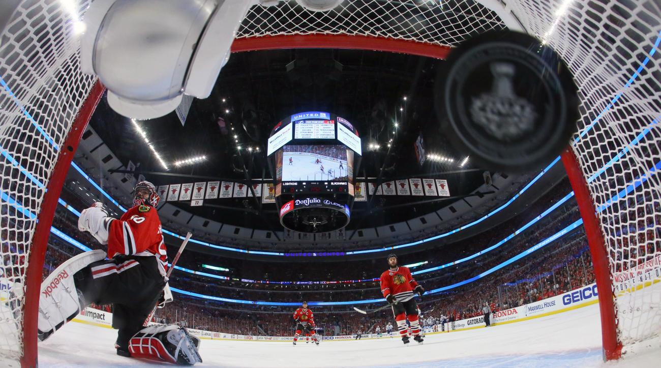 Chicago Blackhawks goalie Corey Crawford (50) watches as Tampa Bay Lightning's Ryan Callahan scores a goal during the first period in Game 3 of the NHL hockey Stanley Cup Final on Monday, June 8, 2015, in Chicago. (Bruce Bennett/Pool Photo via AP)