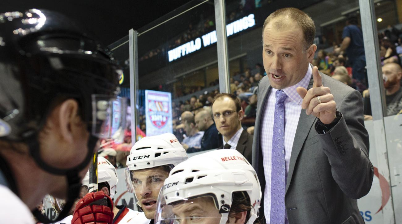 FILE - In this Jan. 31, 2015, file photo, Grand Rapid Griffins head coach Jeff Blashill, right, talks to the referee about a call that went in favor of the Milwaukee Admirals during the third period of an AHL hockey game at Van Andel Arena,in Grand Rapids