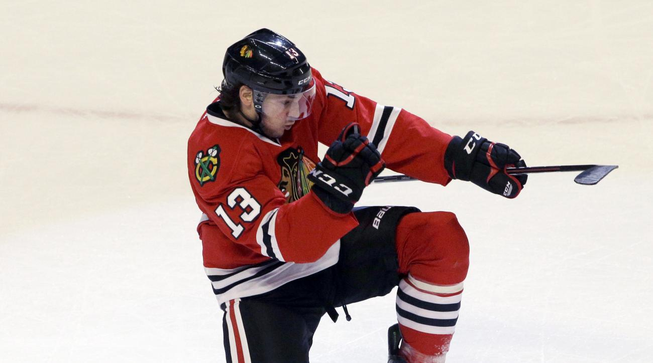 FILE - In this Oct. 11, 2014, file photo, Chicago Blackhawks left wing Daniel Carcillo (13) celebrates after scoring a goal during the third period of an NHL hockey game against the Buffalo Sabres in Chicago. The more he dwelled on close friend and teamma