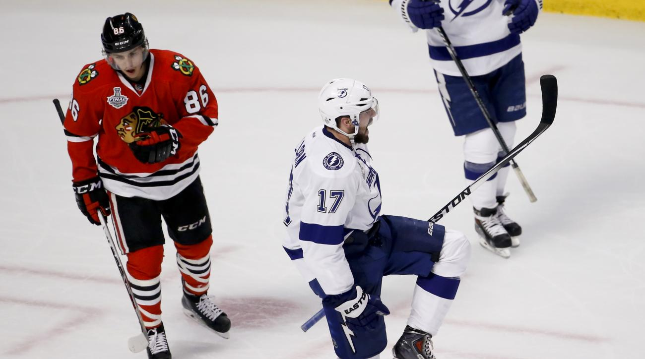 Tampa Bay Lightning's Alex Killorn, right, celebrates as he skates past Chicago Blackhawks' Teuvo Teravainen, of Finland, after scoring during the second period in Game 4 of the NHL hockey Stanley Cup Final Wednesday, June 10, 2015, in Chicago. (AP Photo/