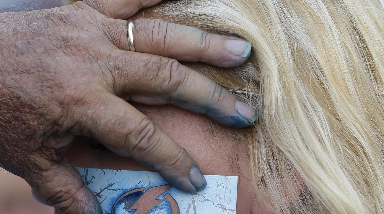 Bryanna White, of Tampa, Fla., has a lightning bolt stenciled on her face before the start of Game 5 of the NHL hockey Stanley Cup Final between the Chicago Blackhawks and the Tampa Bay Lightning, Saturday, June 13, 2015, in Tampa, Fla. (AP Photo/Chris O'