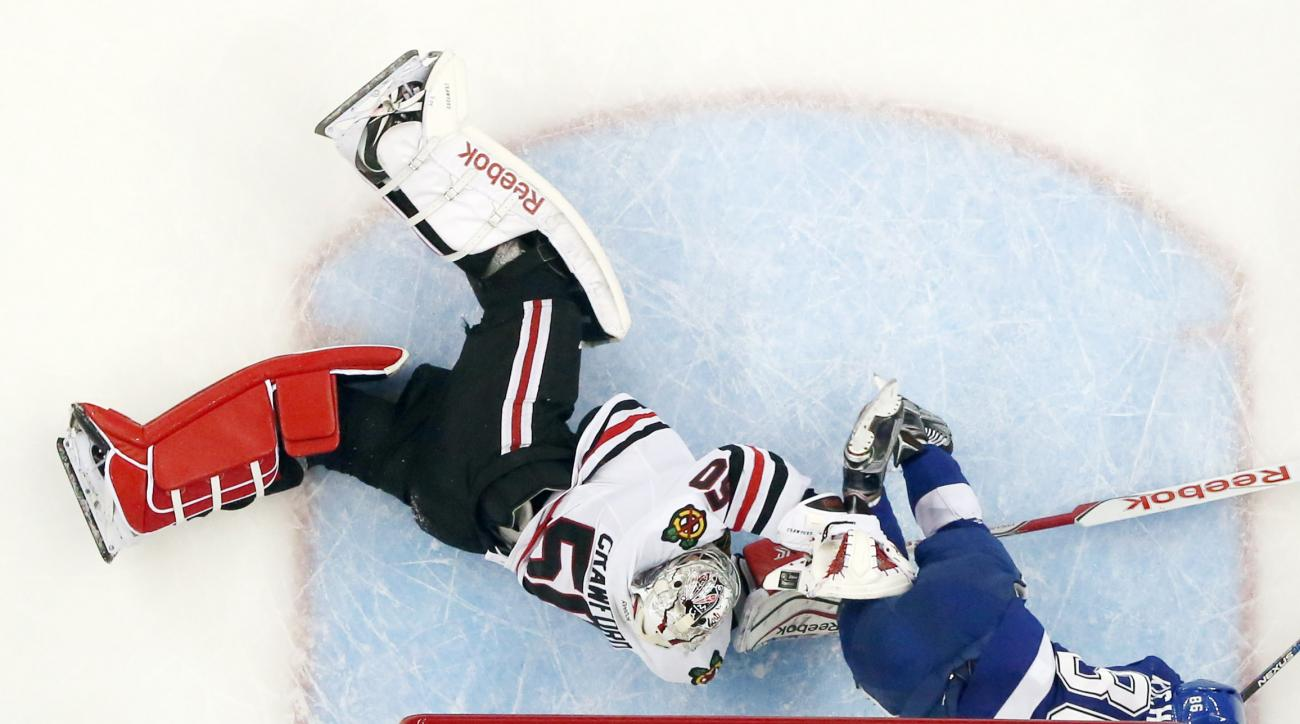 Tampa Bay Lightning right wing Nikita Kucherov (86) hits the goal post as he collides with Chicago Blackhawks goalie Corey Crawford (50) during the first period of Game 5 of the NHL hockey Stanley Cup Final, Saturday, June 13, 2015, in Tampa, Fla. (AP Pho