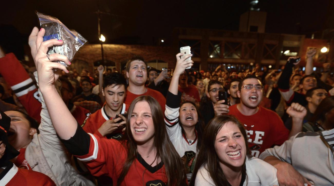 Chicago Blackhawks fans celebrate on Clark Street in the Wrigleyville neighborhood of Chicago after the Chicago Blackhawks defeated the Tampa Bay Lightning to win the Stanley Cup, Monday, June 15, 2015. (AP Photo/Paul Beaty)