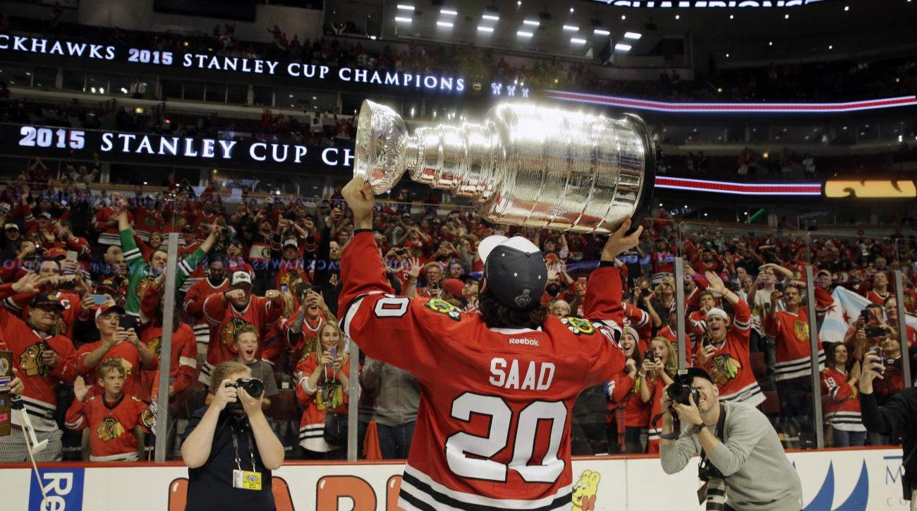 Chicago Blackhawks' Brandon Saad celebrates after defeating the Tampa Bay Lightning in Game 6 of the NHL hockey Stanley Cup Final series on Monday, June 15, 2015, in Chicago. The Blackhawks defeated the Lightning 2-0 to win the series 4-2. (AP Photo/Nam Y