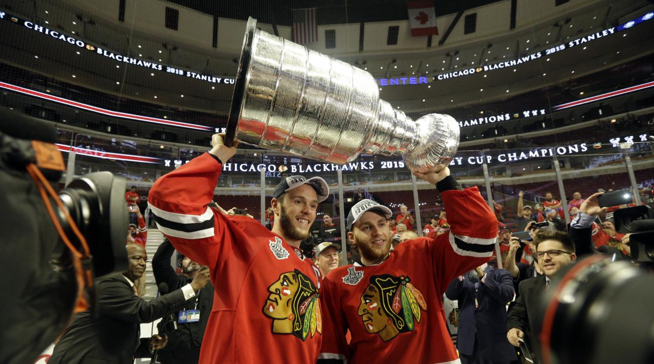 Chicago Blackhawks center Jonathan Toews and Chicago Blackhawks right wing Patrick Kane celebrate after defeating the Tampa Bay Lightning in Game 6 of the NHL hockey Stanley Cup Final series on Monday, June 15, 2015, in Chicago. The Blackhawks defeated th