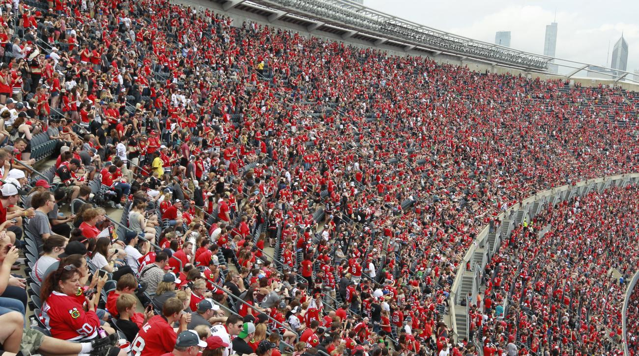 Chicago Blackhawks fans fill Soldier Field during a rally celebrating the NHL hockey club's Stanley Cup championship, Thursday, June 18, 2015, in Chicago. (AP Photo/Christian K. Lee)
