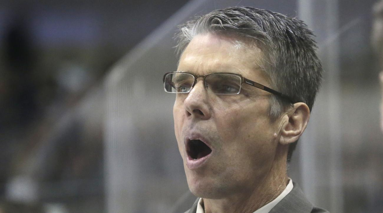 Ottawa Senators head coach Dave Cameron reacts to a call during the first period of an NHL hockey game against the Dallas Stars Tuesday, Jan. 13, 2015, in Dallas. (AP Photo/LM Otero)