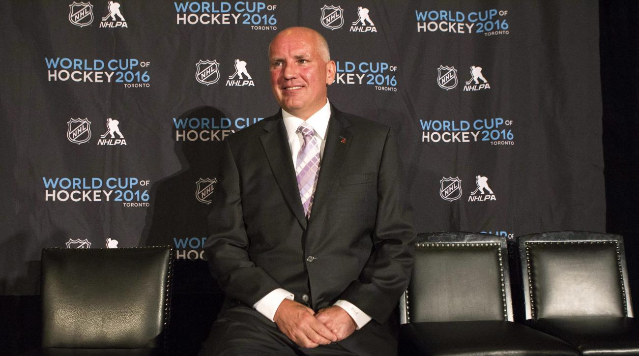 Doug Armstrong smiles during a news conference, Monday, June 22, 2015, in Toronto, introducing him as the general manager of Team Canada for the 2016 World Cup of Hockey. (Chris Young/The Canadian Press via AP) MANDATORY CREDIT