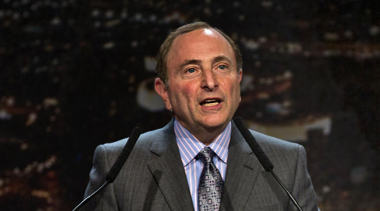 "FILE - In this Feb. 10, 2015, file photo, Gary Bettman, commissioner of the National Hockey League, addresses the crowd during the ""Let's Bring Hockey to Las Vegas!"" news conference at the MGM Grand Ballroom in Las Vegas. With talk of expansion to Las Veg"