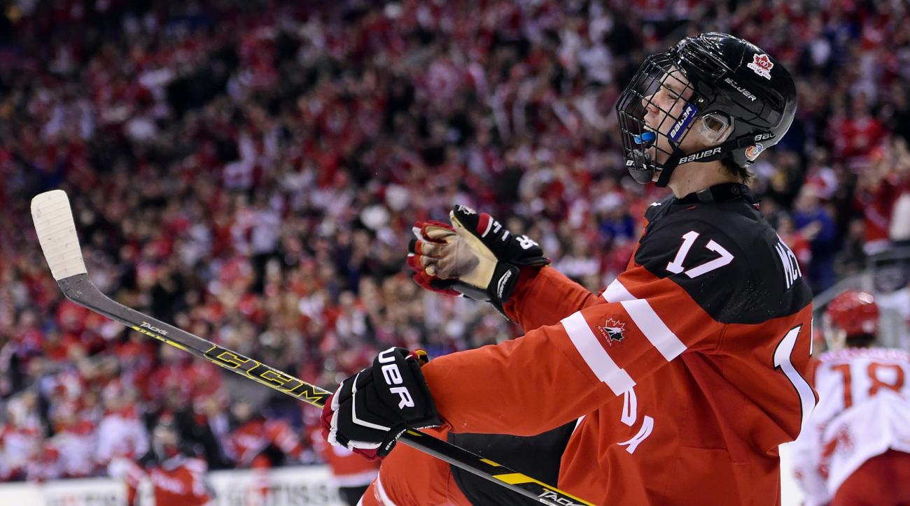 FILE - In this Jan. 2, 2015, file photo, Canada's Connor McDavid celebrates his goal against Denmark during second-period quarterfinal action at the world junior hockey championships in Toronto. For McDavid, this is only the beginning. There's no mystery,
