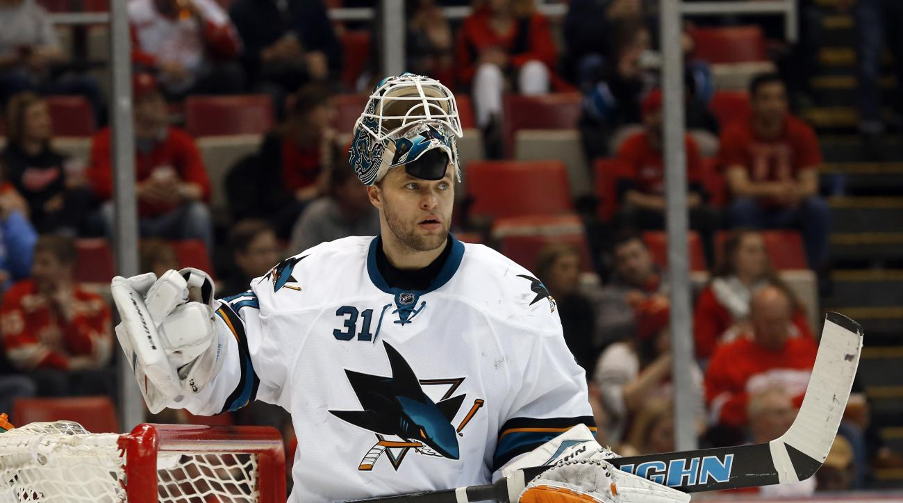 San Jose Sharks goalie Antti Niemi (31) rests during a timeout in the second period of an NHL hockey game against the Detroit Red Wings in Detroit Thursday, March 26, 2015.  (AP Photo/Paul Sancya)