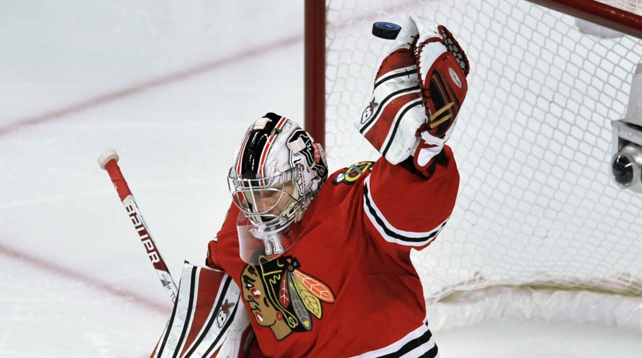 Chicago Blackhawks goalie Antti Raanta of Finland, makes a save during the third period of an NHL hockey game against the Toronto Maple Leafs in Chicago, Sunday, Dec. 21, 2014. Chicago won 4-0. (AP Photo/Paul Beaty)