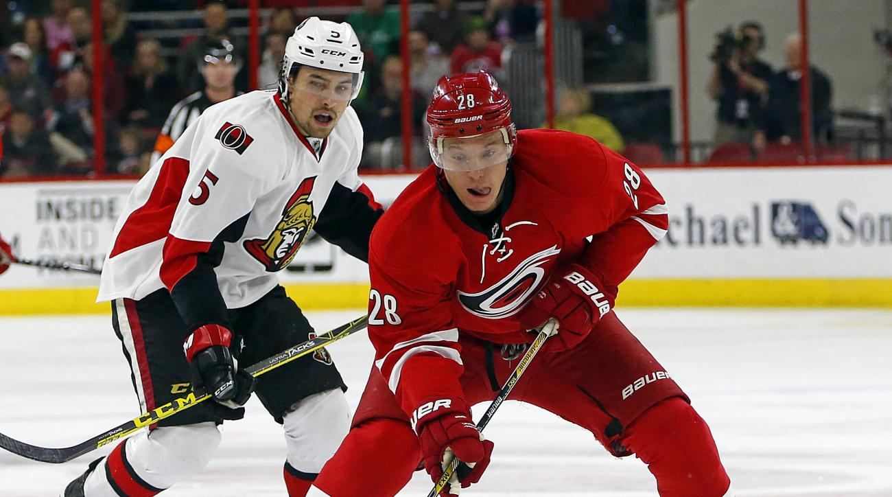 Carolina Hurricanes' Alexander Semin (28) of Russia, brings the puck up the ice after taking it away from Ottawa Senators' Cody Ceci (5) during the second period of an NHL hockey game, Tuesday, March 17, 2015, in Raleigh, N.C. (AP Photo/Karl B DeBlaker)