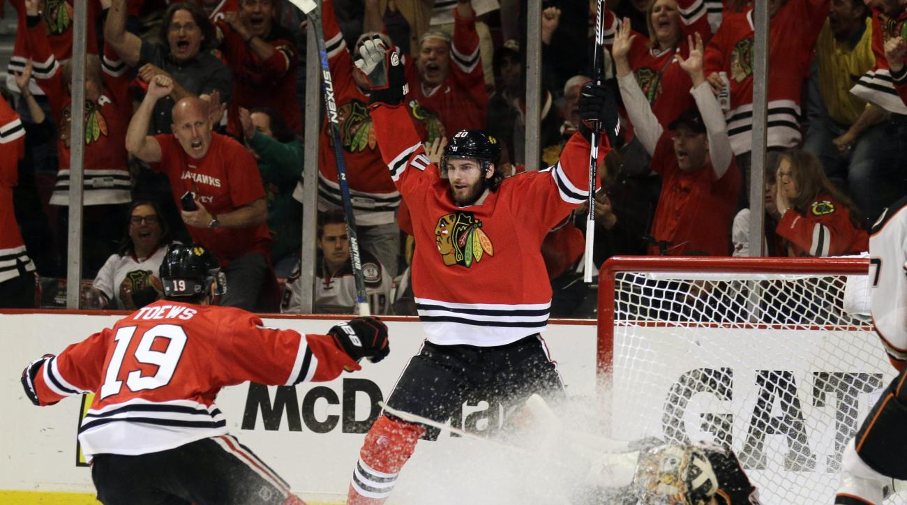 FILE - In this Wednesday, May 27, 2015, file photo, Chicago Blackhawks left wing Brandon Saad celebrates his goal against Anaheim Ducks goalie Frederik Andersen with Jonathan Toews (19) during the second period in Game 6 of the Western Conference finals o