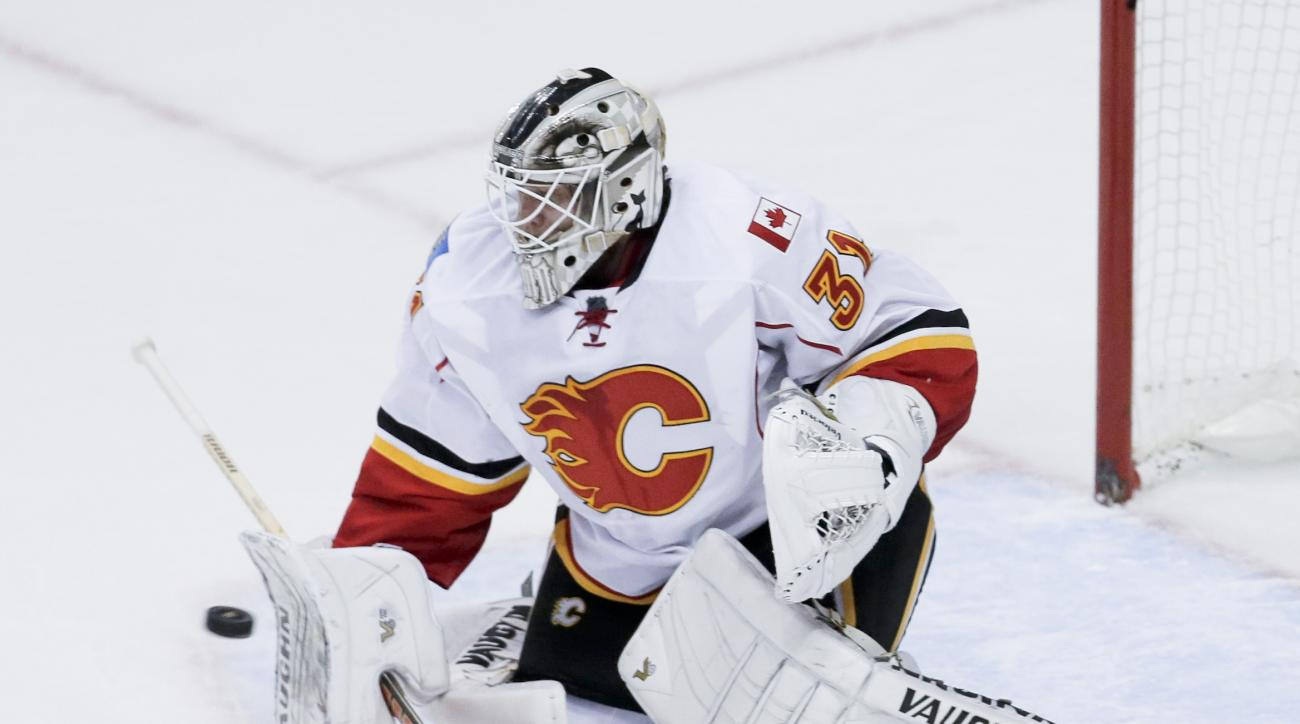Calgary Flames goalie Karri Ramo blocks a shot against the Anaheim Ducks during the first period of Game 5 in an NHL hockey second-round playoff series in Anaheim, Calif., Sunday, May 10, 2015. (AP Photo/Chris Carlson)
