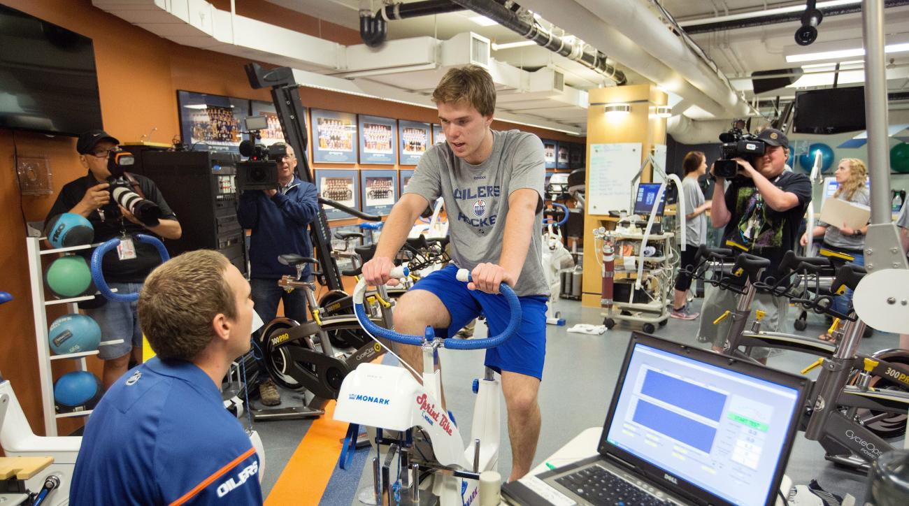 NHL hockey first overall draft pick Connor McDavid rides a stationary bike during the Edmonton Oilers Orientation Camp in Edmonton, Alberta, Wednesday,  July 1, 2015. (Amber Bracken/The Canadian Press via AP)
