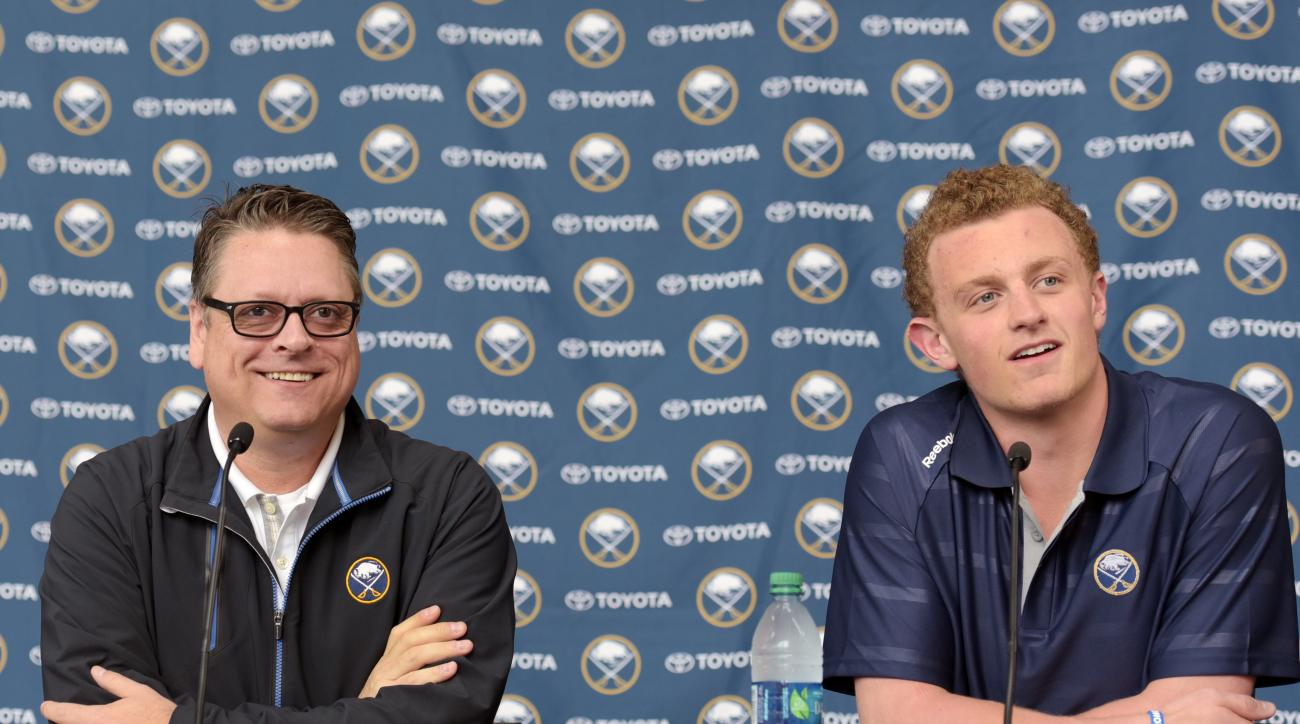 Buffalo Sabres GM Tim Murray, left, reacts with Jack Eichel during an NHL press conference at the First Niagara Center Wednesday July 1, 2015, in Buffalo, N.Y. Eichel signed a three-year, entry-level contract. (AP Photo/Gary Wiepert)