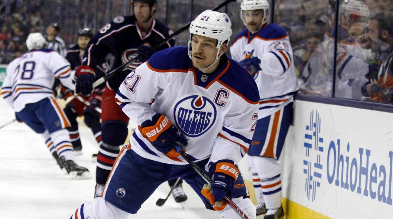 FILE - In this Nov. 29. 2013, file photo, Edmonton Oilers' Andrew Ference carries the puck against the Columbus Blue Jackets during an NHL hockey game in Columbus, Ohio. Decades after he collected bottles to take to the recycling depot for money while he