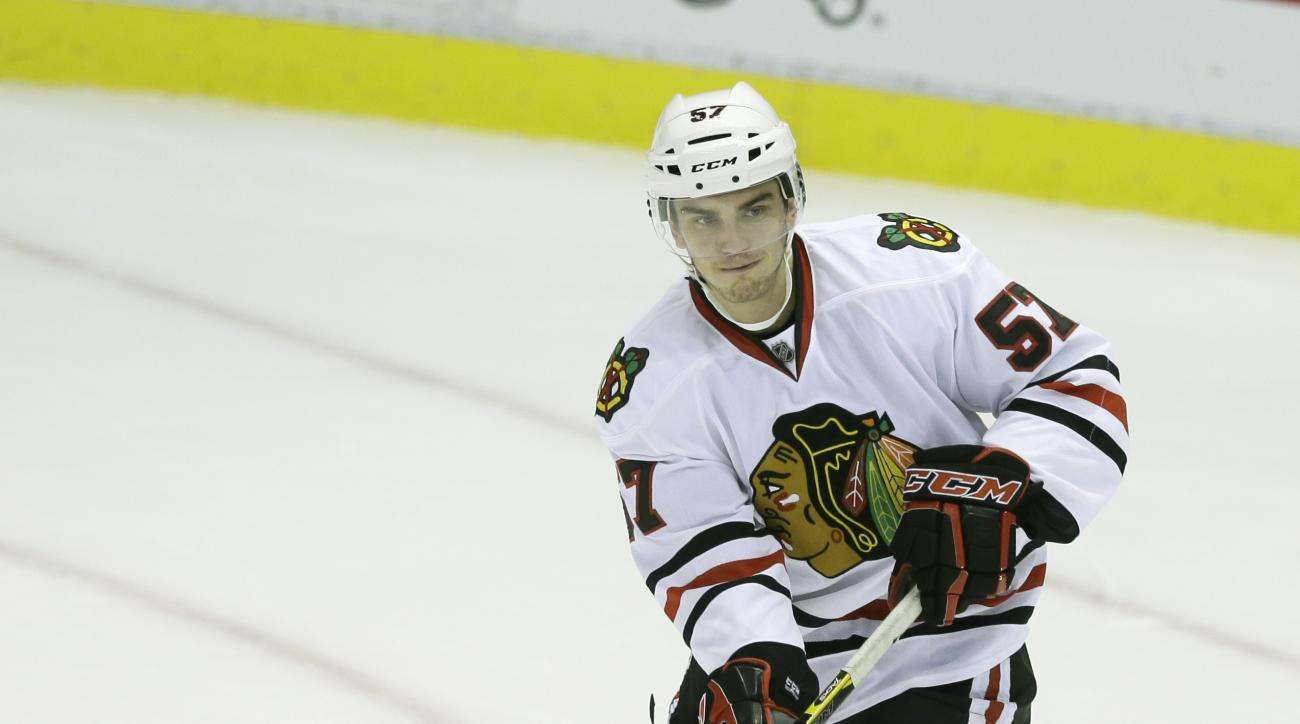 Chicago Blackhawks defenseman Trevor van Riemsdyk (57) passes during the second period of an NHL hockey game against the Detroit Red Wings in Detroit, Thursday, Sept. 25, 2014. (AP Photo/Carlos Osorio)