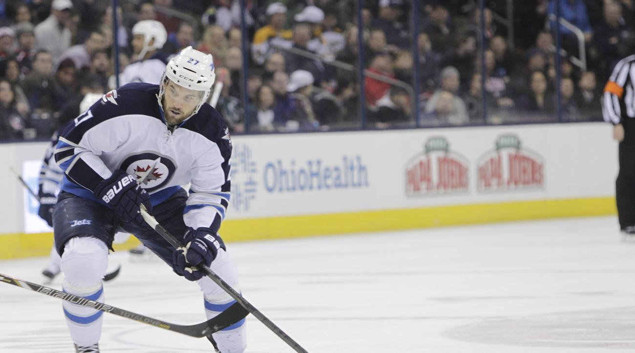 Winnipeg Jets' Eric Tangradi plays against the Columbus Blue Jackets during an NHL hockey game Monday, Dec. 16, 2013, in Columbus, Ohio. (AP Photo/Jay LaPrete)