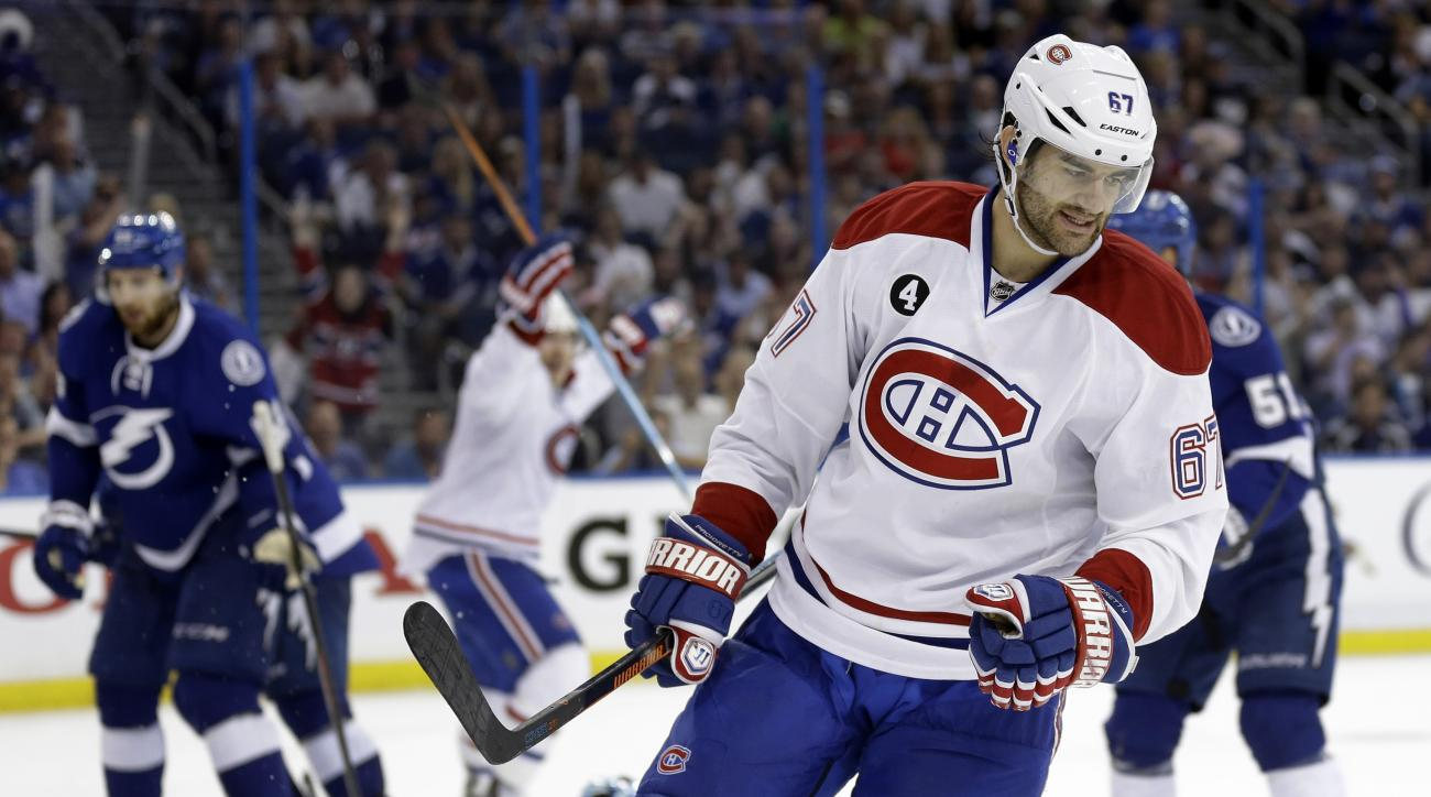 Montreal Canadiens left wing Max Pacioretty (67) celebrates after scoring against the Tampa Bay Lightning during the third period of Game 6 of a second-round NHL Stanley Cup hockey playoff series Tuesday, May 12, 2015, in Tampa, Fla. The Lightning won the