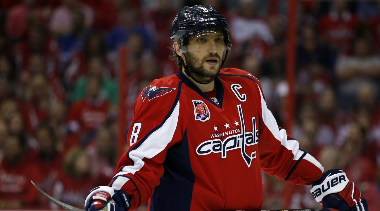 Washington Capitals left wing Alex Ovechkin (8), from Russia, pauses on the ice during the first period of Game 4 in the second round of the NHL Stanley Cup hockey playoffs against the New York Rangers, Wednesday, May 6, 2015, in Washington. (AP Photo/Ale