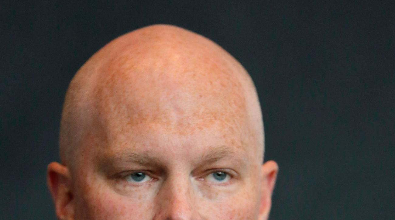 John Hynes speaks after being introduced as the new head coach of the New Jersey Devils during an NHL hockey news conference, Tuesday, June 2, 2015, in Newark, N.J. (AP Photo/Julio Cortez)