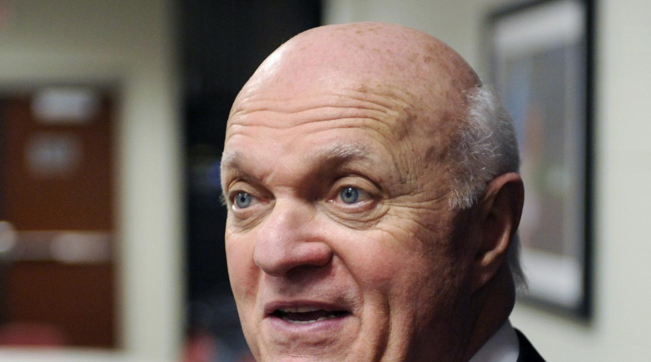 FILE - In this April 14, 2014, file photo, then-New Jersey Devils general manager Lou Lamoriello talks to the media in Newark, N.J. The Toronto Maple Leafs have hired longtime NHL executive Lou Lamoriello as general manager. Maple Leafs President Brendan