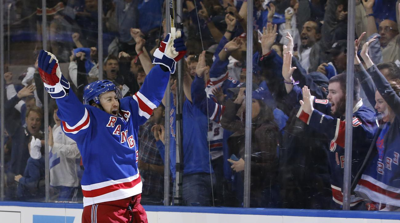 New York Rangers center Derek Stepan (21) celebrates his second period goal against the Tampa Bay Lightning in Game 1 of the Eastern Conference final during the NHL hockey Stanley Cup playoffs, Saturday, May 16, 2015, in New York. (AP Photo/Kathy Willens)