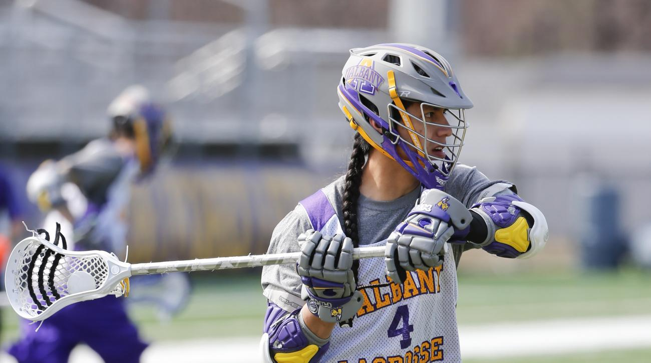 FILE - In this April 16, 2015, file photo, University at Albany lacrosse player Lyle Thompson practices in Albany, N.Y. Senior Lyle Thompson is at the point in his lacrosse career at Albany where his next game could be his last. The all-time leading score