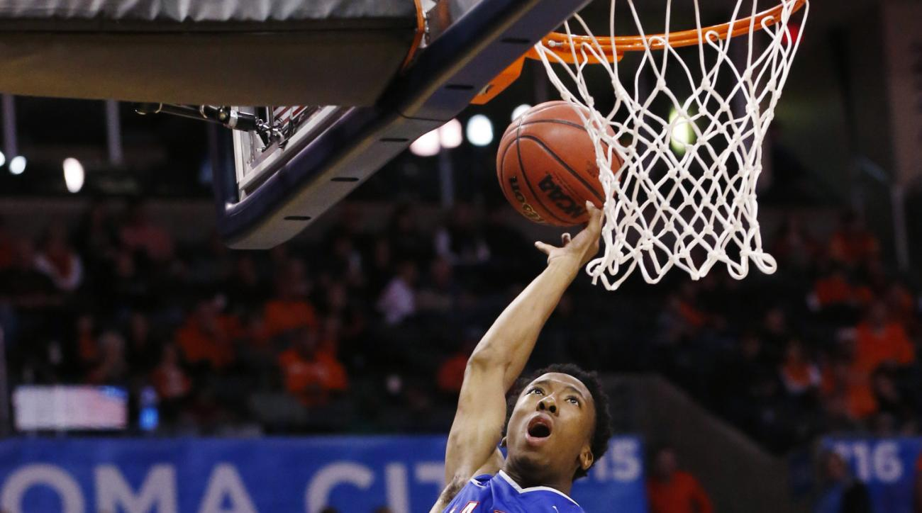 Louisiana Tech guard Raheem Appleby (3) shoots during an NCAA college basketball game between Oklahoma State and Louisiana Tech at the All College Classic in Oklahoma City, Sunday, Dec. 15, 2013. (AP Photo/Sue Ogrocki)
