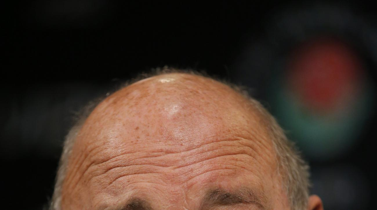 Wisconsin athletic director Barry Alvarez talks to reporters during the Rose Bowl media day in Los Angeles, Saturday, Dec. 29, 2012. Wisconsin will face Stanford in the Rose Bowl NCAA college football game on New Year's Day in Pasadena, Calif. (AP Photo/J