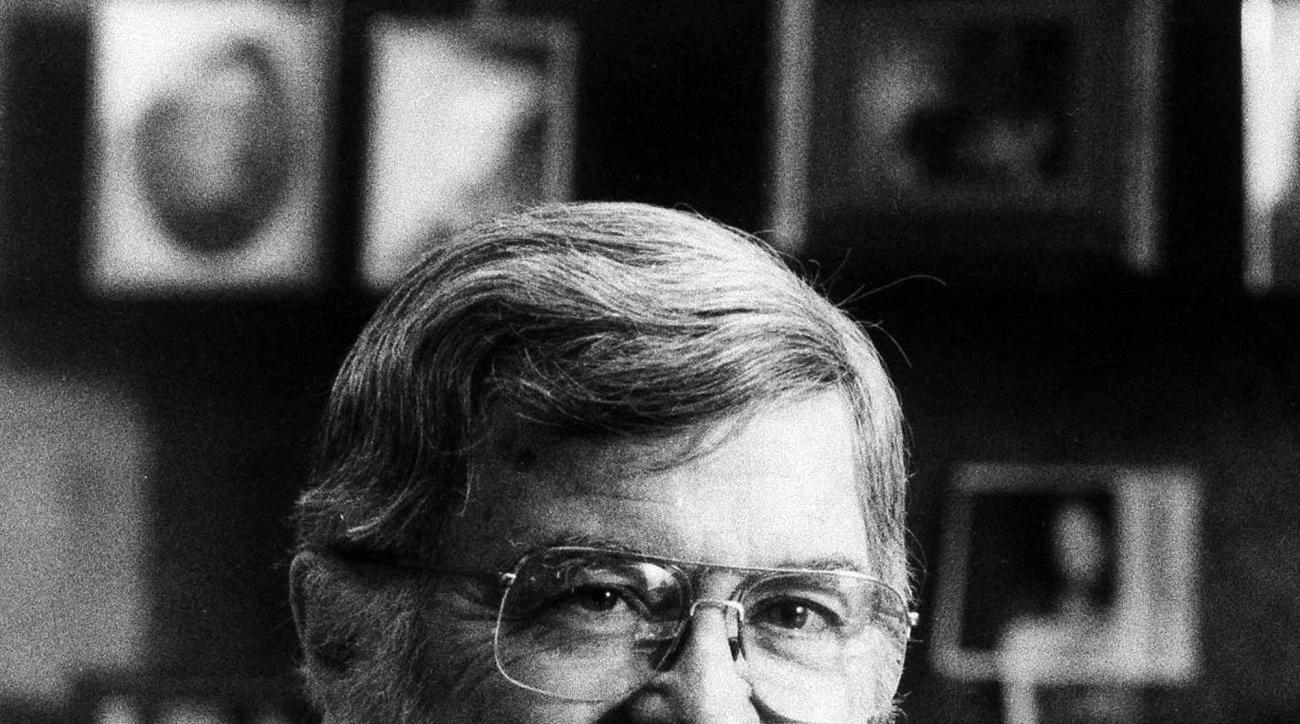 FILE - In this Dec. 1, 1986, file photo, NCAA director Walter Byers poses in his  office in Mission, Kan. Byers, the first executive director of the NCAA who spent 36 years leading and shaping the organization, has died. He was 93. (AP Photo/Cliff Schiapp