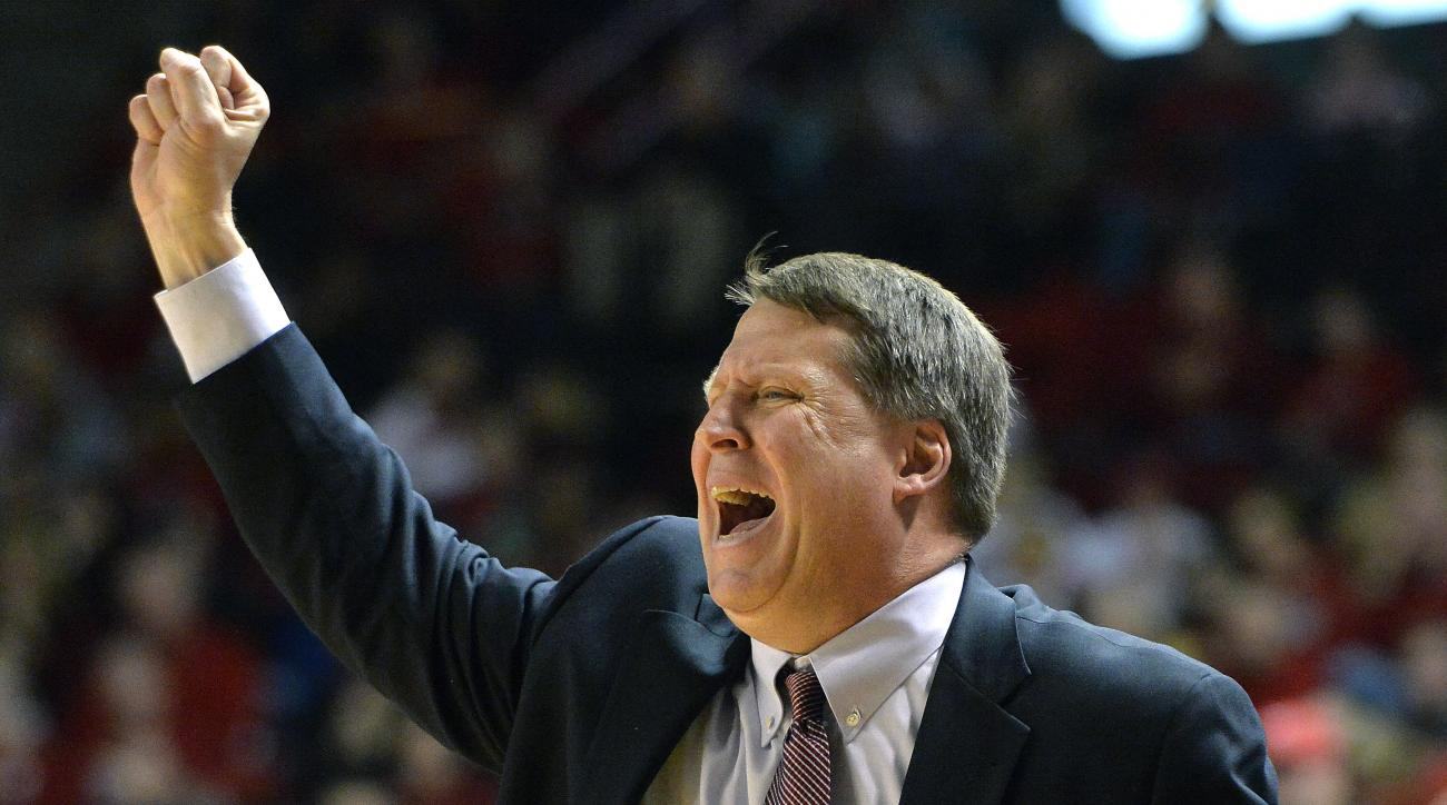 Old Dominion head coach Jeff Jones shouts instructions to his team during the second half of their NCAA basketball game against Western Kentucky, Saturday, Jan. 10, 2015, in Bowling Green, Ky.  Western Kentucky won 72-65. (AP Photo/Timothy D. Easley)