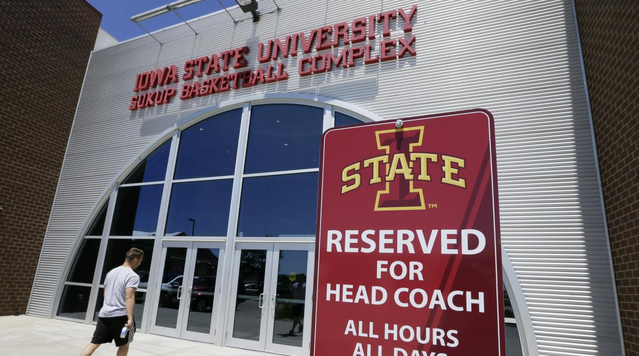 A sign sits in front of Iowa State basketball head coach Fred Hoiberg's vacant parking space, Monday, June 1, 2015, in Ames, Iowa. Hoiberg, who has been the coach at Iowa State for five seasons, has been linked to the opening with the NBA's Chicago Bulls.