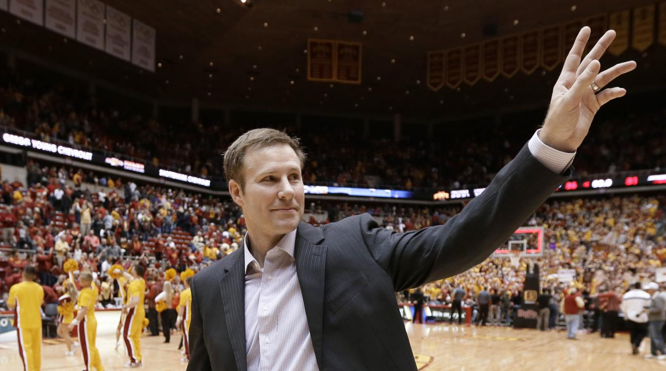File- This Jan. 17, 2015, file photo shows Iowa State coach Fred Hoiberg waving to fans as he walks off the court after his team's NCAA college basketball game in Ames, Iowa. The Chicago Bulls plan to introduce Hoiberg as their new coach on Tuesday, June