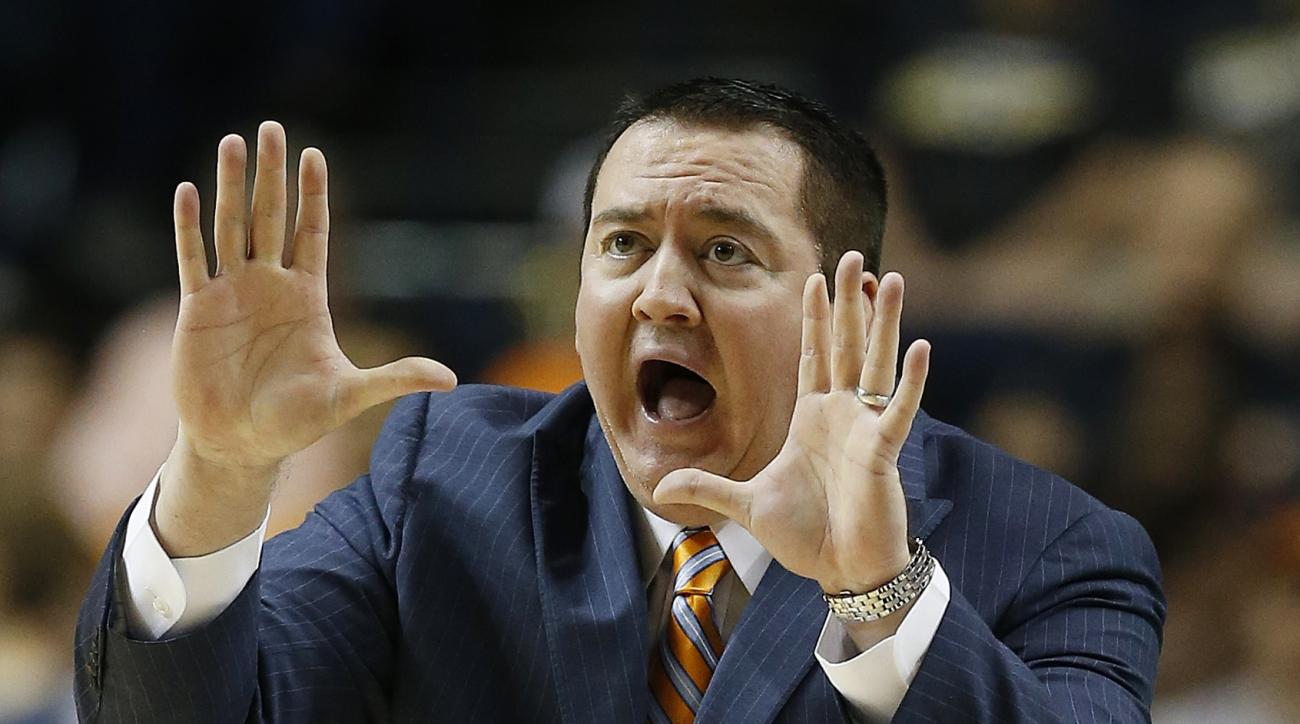 FILE - In this March 12, 2015, file photo, Tennessee head coach Donnie Tyndall speaks to players during the first half of an NCAA college basketball game in the second round of the Southeastern Conference tournament against Vanderbilt in Nashville, Tenn.