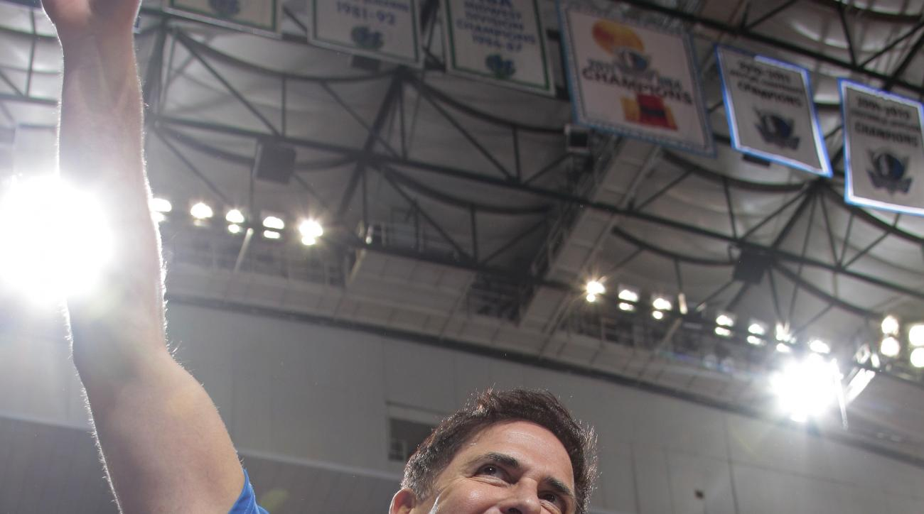 DALLAS, TX - APRIL 24:  Mark Cuban, owner of the Dallas Mavericks waves to the crowd against the Houston Rockets during Game Three of the Western Conference Quarterfinals of the 2015 NBA Playoffs on April 24, 2015 at the American Airlines Center in Dallas